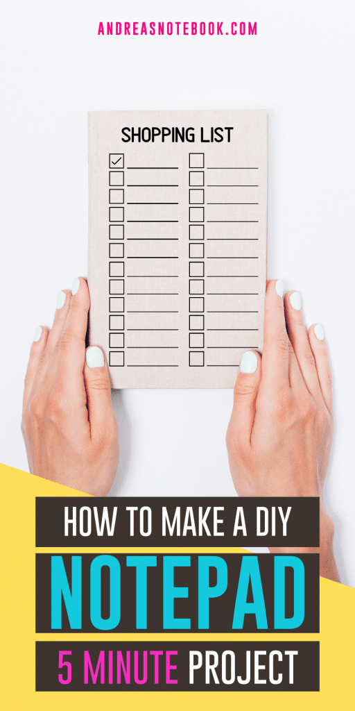 text: how to make a diy notepad - image: white table, lined notepad open on top with two hands holding notepad open. Notepad binding is at top of the notepad.