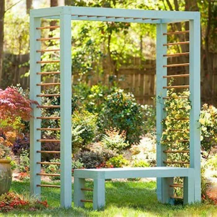 green garden with turquoise simple pergola with bench