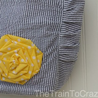 Gray striped purse with a yellow rosette for Purse Week!