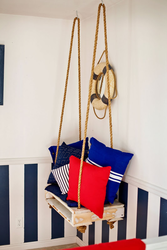 You can make a hanging pallet chair.