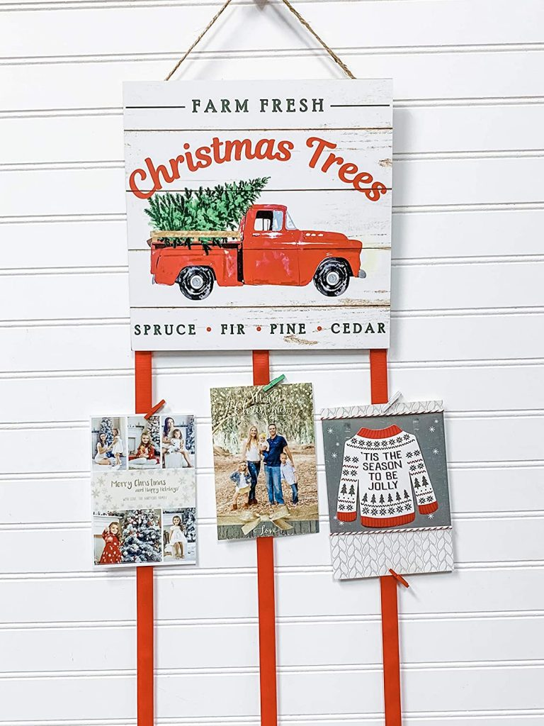 red truck white wall christmas card display ribbon