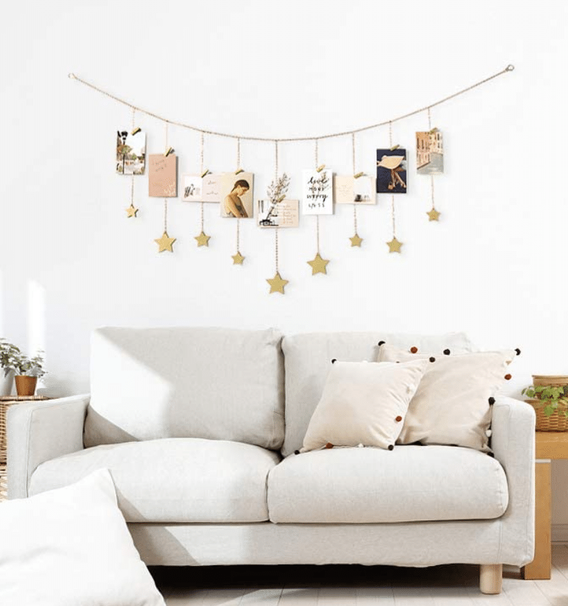 white sofa stars hanging cards