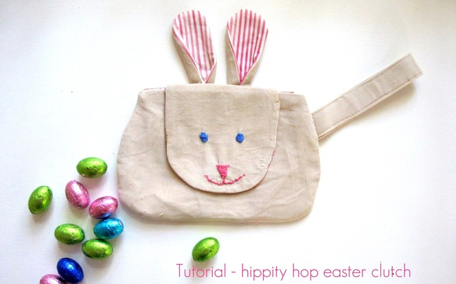 Clutch purse with bunny face on flap and ears