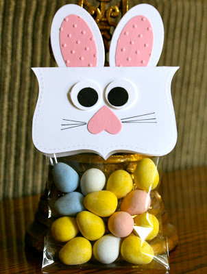 Top a plastic treat bag with a simple card paper bunny face