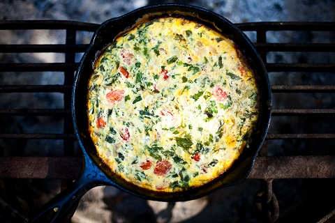 Breakfast frittata with tomatoes, basil, and cheddar cheese