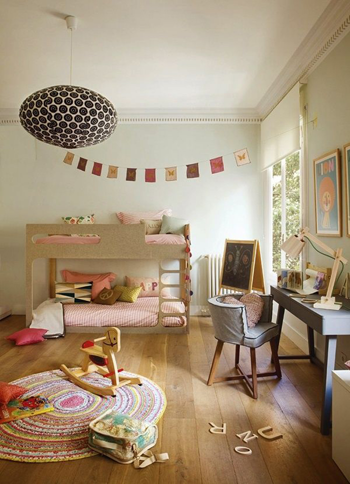 girl's room with playspace and bunk bed