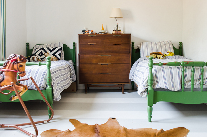 shared boys room with painted green beds
