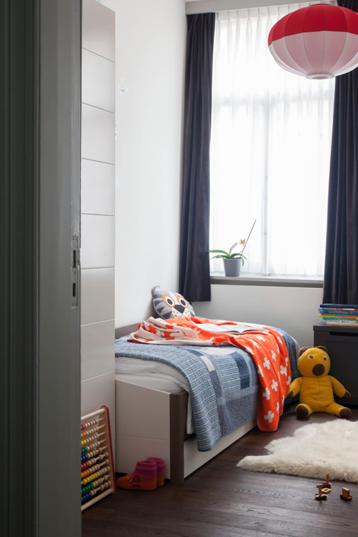 minimal children's room with a pop of color