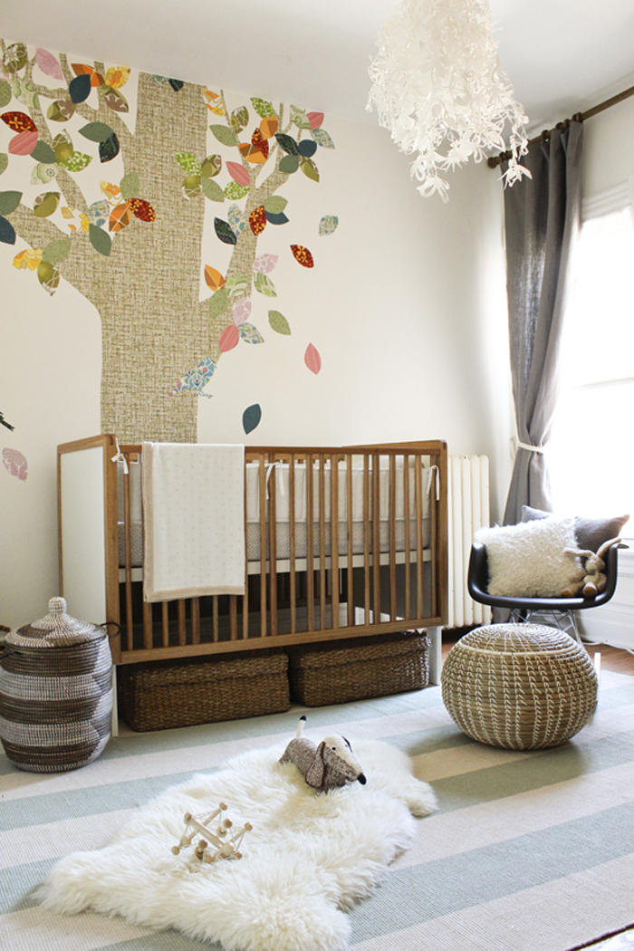 welcoming + neutral nursery with tree decal