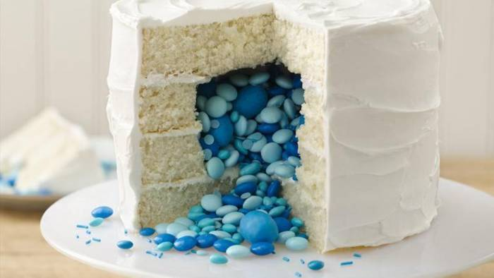 Bake a candy filled cake for a gender reveal party!  Easy instructions!