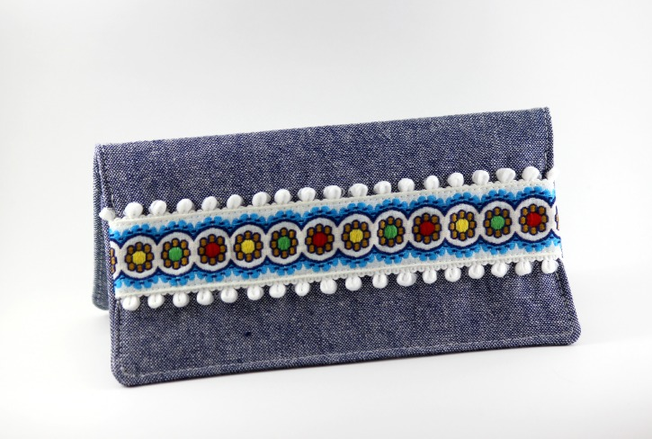 Checkbook cover with horizontal ribbon and trim