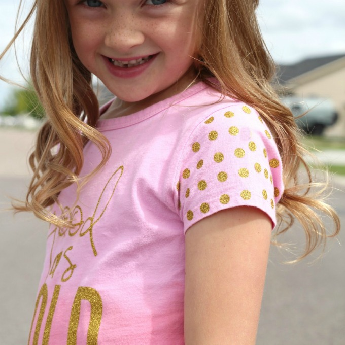 Learn how to embellish a plain t-shirt with heat transfer vinyl with this awesome tutorial (complete with polka dot sleeves!)