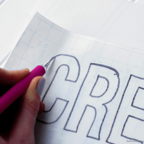 "cutting out ""cre"" out of paper"