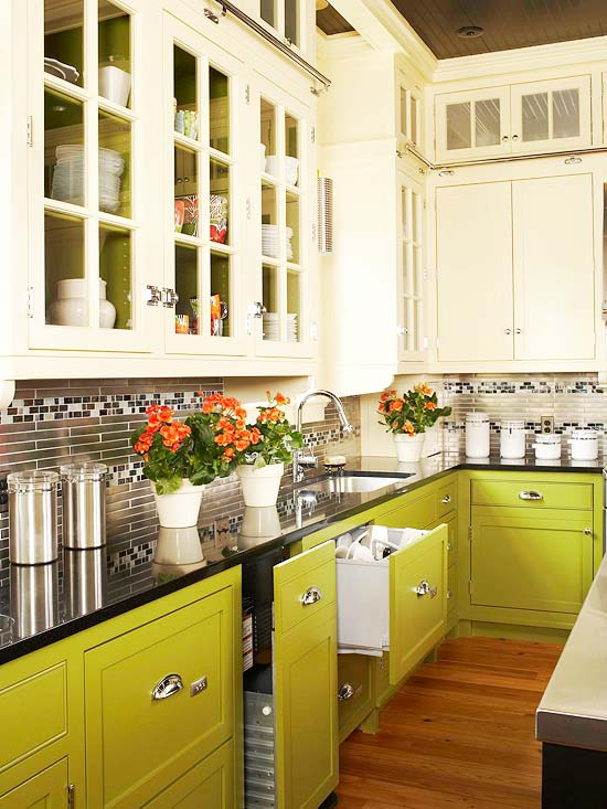 Two Toned Kitchen Cabinet Trend - Green kitchen cabinets with black countertops
