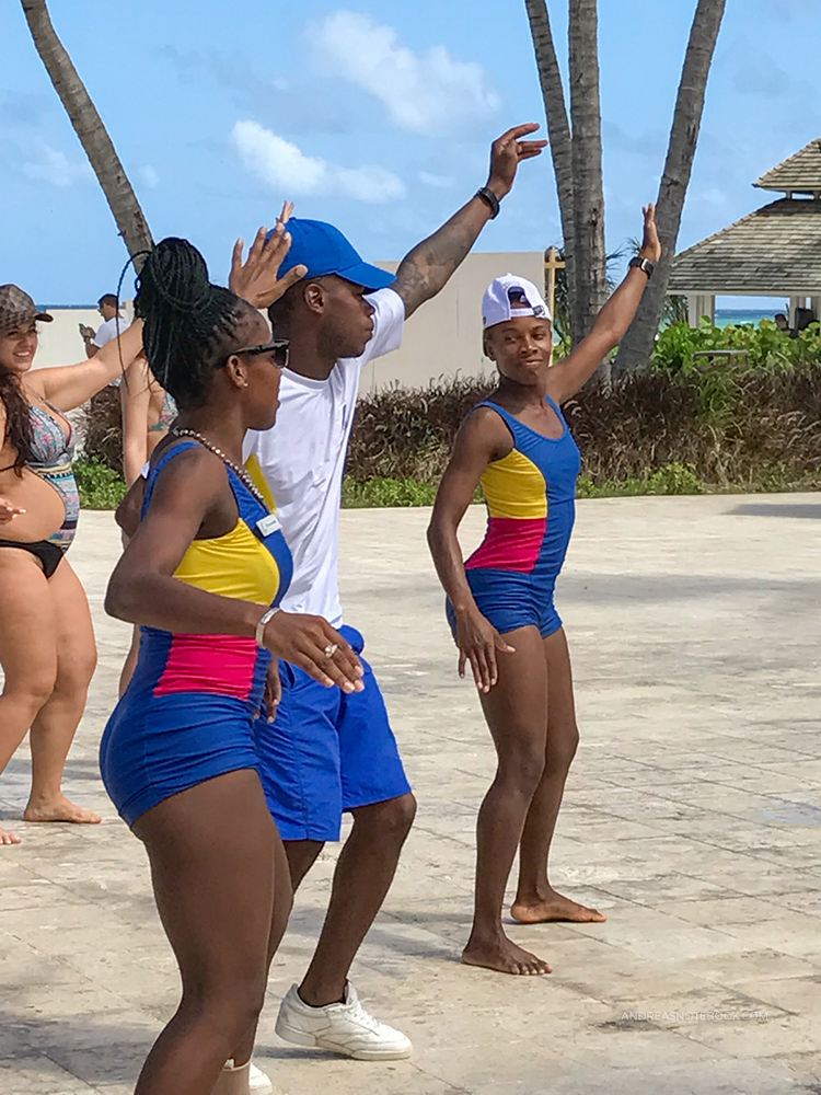All-inclusive resorts have lots of poolside entertainment and activities. Join in! Here, three dancers are teaching the guests to dance like a local!