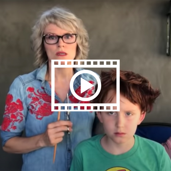 woman looks shocked at her terrible haircut on her son