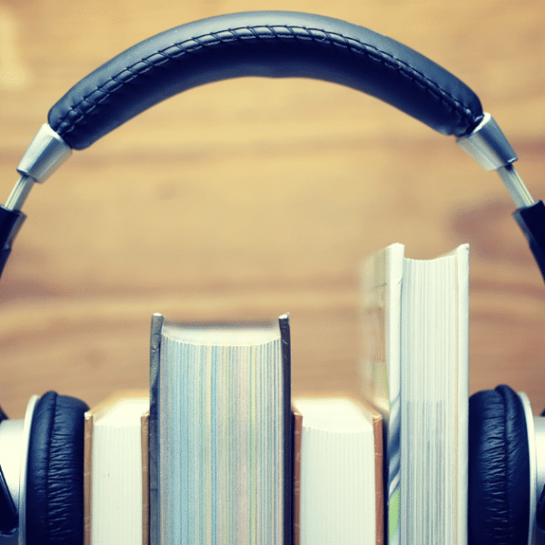 black over ear headphones over a stack of books