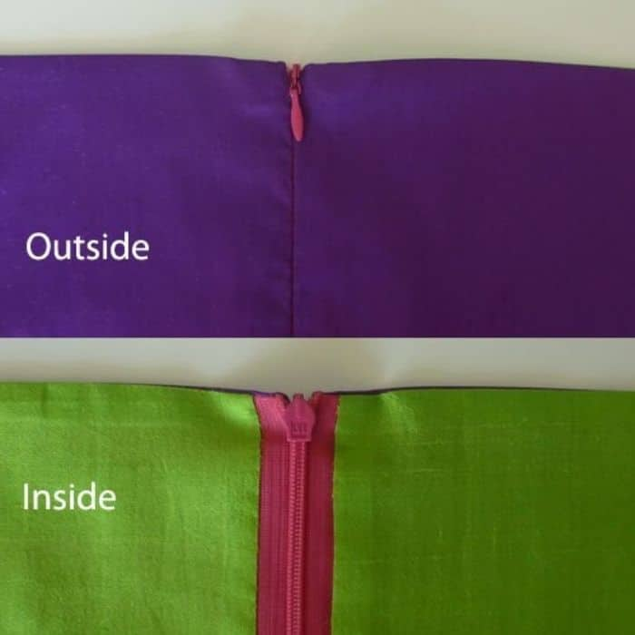 image of inside and outside of lined garment highlighting zipper. Outside zipper doesn't show, inside zipper is pink with green fabric
