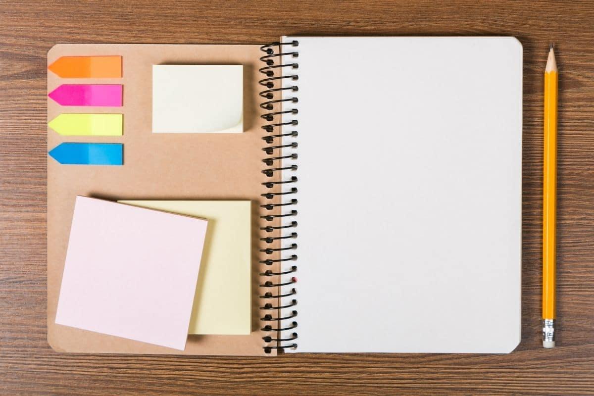 open blank notebook on wood grain