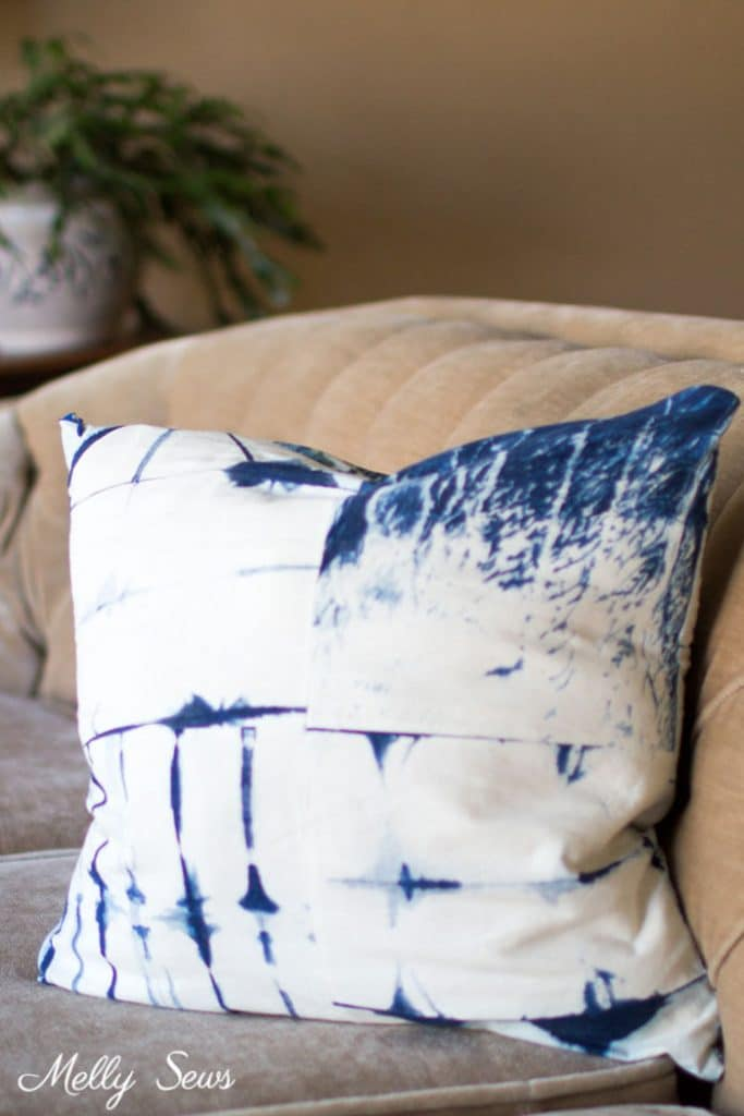 blue and white shibori dyed pillow on beige couch with invisible zipper sewn with an invisible zipper foot.