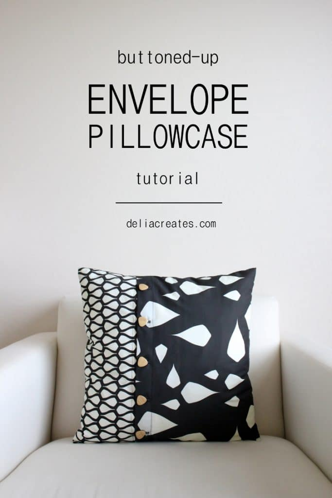 text: buttoned up envelope pillowcase tutorial by deliacreates.com - black and white pillow with buttons up the front sitting on a white chair.