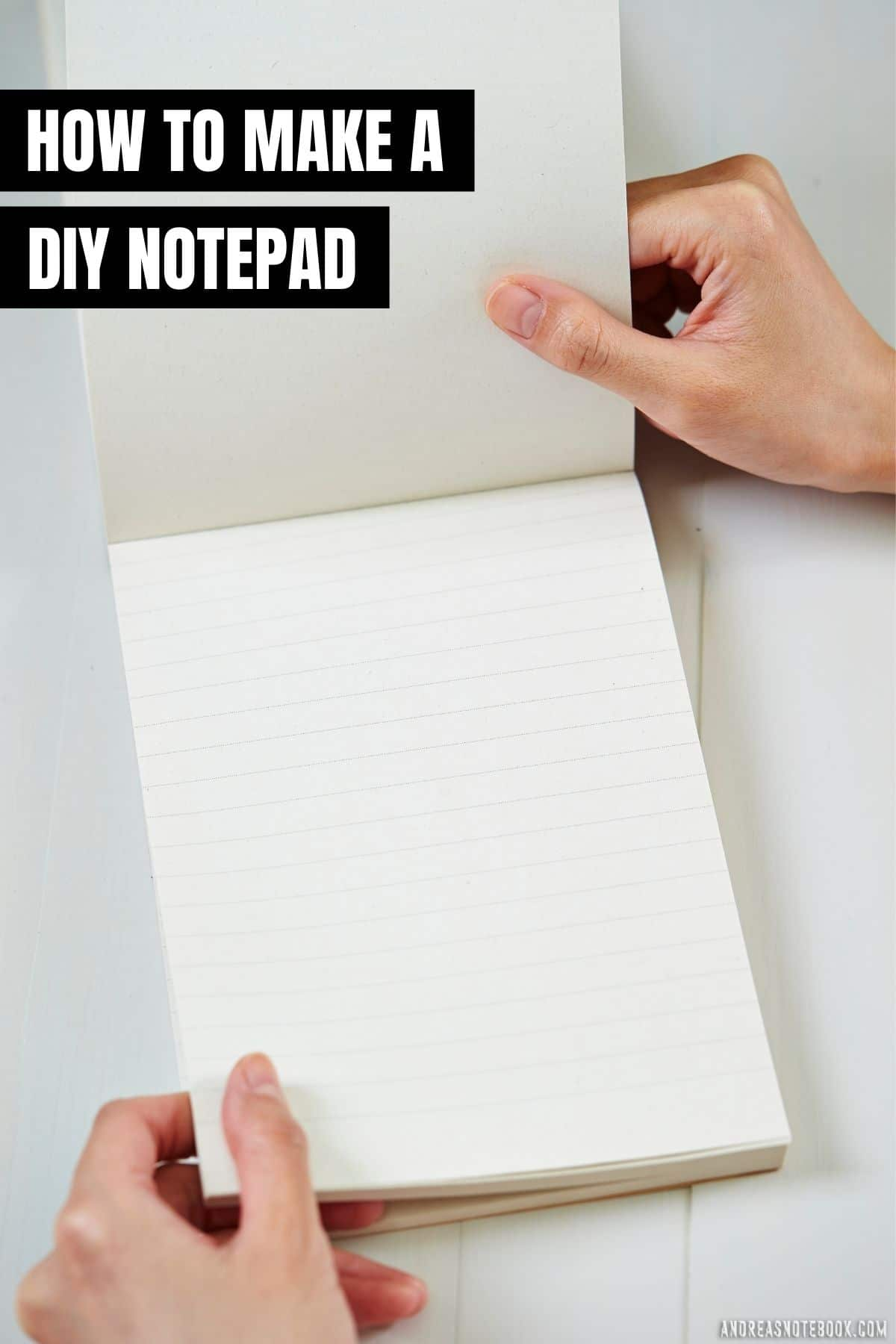 text: how to make a diy notepad - image: white table, lined notepad open on top with two hands holding notepad open. Padding compound glue for binding notepads is at top of the notepad.