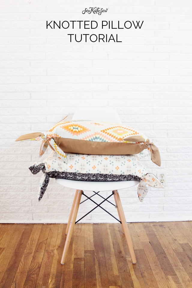 two pillows with knots on the corners sitting on white mid century modern chair. Hardwood floors with white background. Text says knotted pillow cover tutorial - learn how to make a pillow cover with zipper