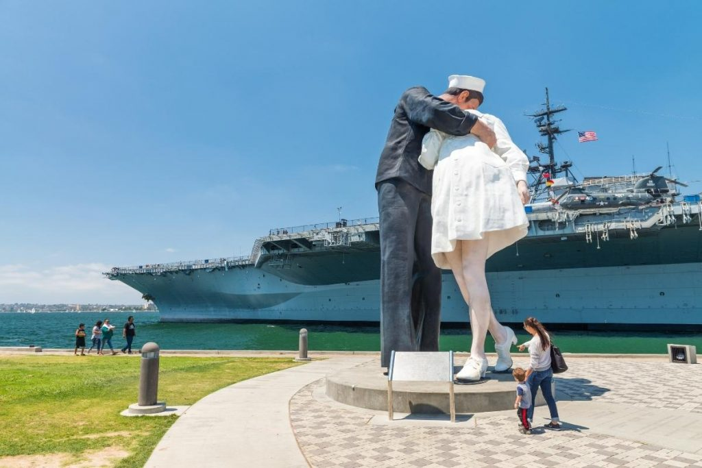 Iconic giant sculpture of sailor kissing a nurse in park along the water next to the USS Midway Museum